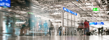 People In The Airport. Motion Blur Stock Photo