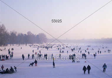 People on Frozen Lake Stock Photo