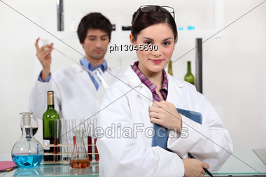 People Working In A Wine Laboratory Stock Photo