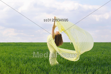 Perfect Girl Dancing In A Green Field Stock Photo