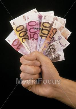 person holding euros Stock Photo