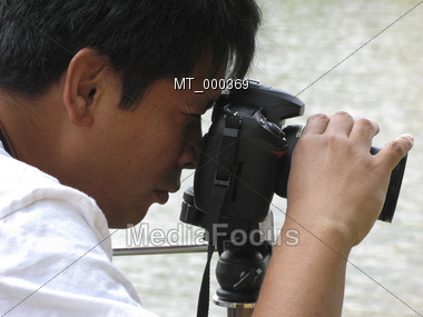 Photographer Taking Pictures Stock Photo