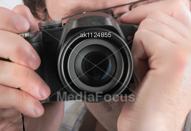 Photographer With A Black Compact Digital Camera Stock Photo
