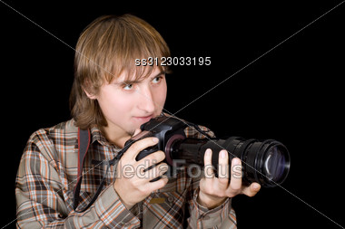Photographer With The Camera With A Telefocus Lens Stock Photo