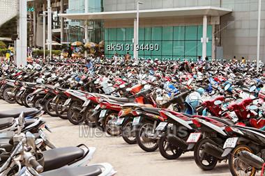 PHUKET, THAILAND - NOVEMBER 20: Many Motorbikikes At The Parking Near Big Store On November, 20, 2010, Phuket, Thailand. Motorbike Is A Most Popular Transport In Thailand Stock Photo
