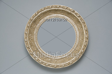 Picture Gold Frame With A Decorative Pattern On A Gray Wall Stock Photo