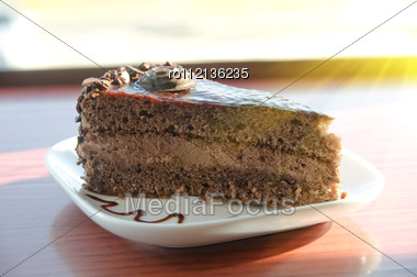 Piece Of Chocolate Cake At White Plate Stock Photo