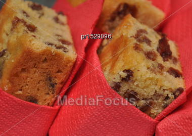 Pieces Of Fruit Cake Wrapped In Red Serviettes Stock Photo