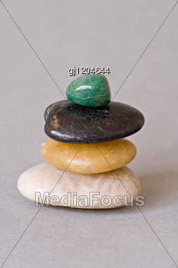 Pile Of Stones Isolated On Grey Background Stock Photo