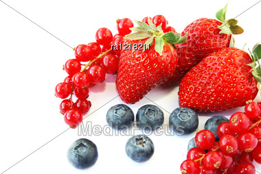 Pile Of Strawberries, Red Currants, Blueberries, Mulberries Isolated On White Background. Stock Photo