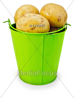 Pile Of Yellow Potatoes In A Small Green Bucket Isolated On White Background Stock Photo