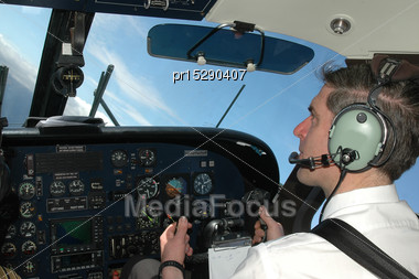 Pilot At Aircraft Cockpit In Dornier 228 Stock Photo