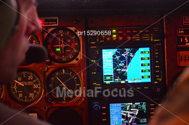 Pilot Of A Light Aeroplane Checks His Instruments During Flight Stock Photo