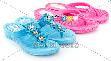 Pink And Blue Flip Flops Isolated On White Background Stock Photo