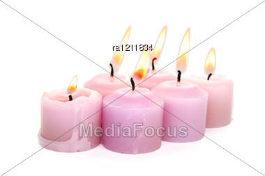 Pink Burning Candles Stock Photo