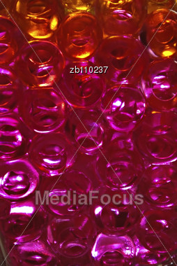 Pink And Orange Jelly Balls In Glass Vase Stock Photo