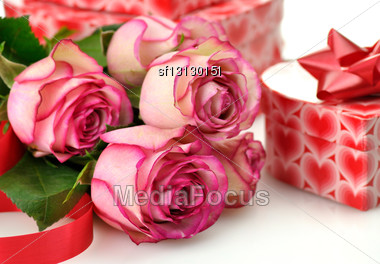 Pink Roses And Gift Box Stock Photo