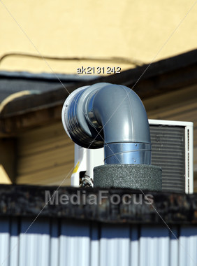 Pipe Of Ventilation Are Located On A Roof Of A Building Stock Photo