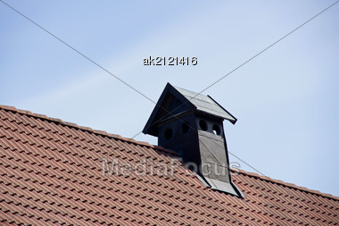Pipe Of Ventilation On A Roof Of Tiles Stock Photo
