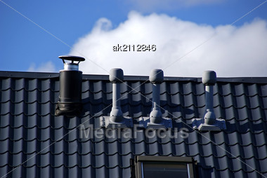 Pipes Of Ventilation Are Located On A Roof Of A Building Stock Photo