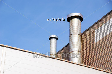 Pipes Of Ventilation Are Located On A Wall Of An Industrial Building Stock Photo