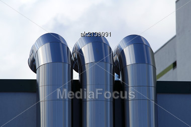Pipes Of Ventilation Are Located On A Wall Of A Residential Building Stock Photo