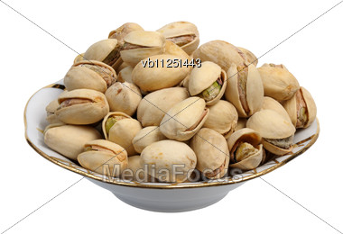 Pistachios On A Plate Stock Photo