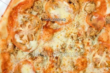 Pizza Closeup With Chicken Fillet, Tomato And Mozzarella Cheese Stock Photo