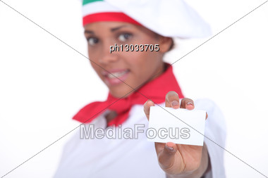 Pizzeria Chef Holding Business Card Stock Photo