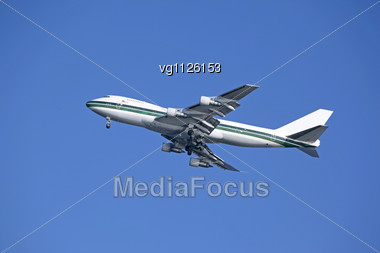 Plane In The Sky Over Blue Background Stock Photo