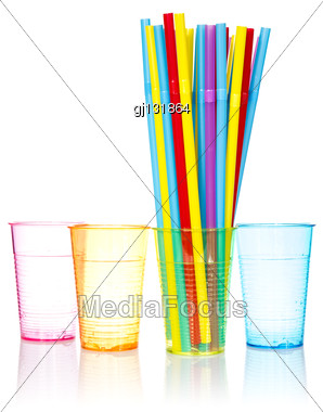 Plastic Colored Glasses And Bunch Of Colorful Straws Stock Photo