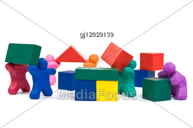 Plasticine People Working As A Team, Building Wooden Blocks Stock Photo
