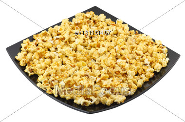 Plate With Fresh Caramel Popcorn. Isolated. Close-Up. Isolated Stock Photo