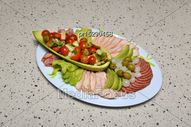 Plate Of Tempting Salad Vegetables And Sliced Meats Stock Photo