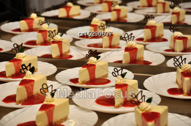 Plates Of Cheesecake Ready To Serve At A Reception Stock Photo