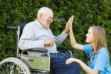 Playful Doctor With Patient At The Nursing Home Stock Photo