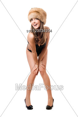 Playful Lady Wearing Black Swimsuit And Fur-cap. Stock Photo