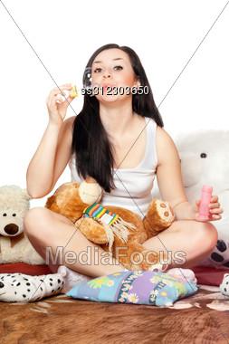 Playful Pretty Girl Blow Bubbles. Stock Photo