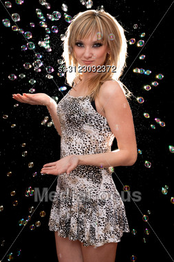Playful Pretty Young Blonde On Background Of A Soap Bubbles Stock Photo