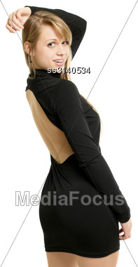 Playful Sexy Blonde Posing In Black Dress And Showing Her Naked Back Stock Photo