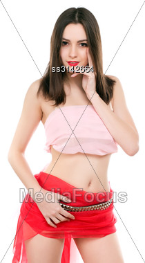 Playful Smiling Brunette Wearing Fabric Red Skirt And Pink Top. Isolated On White Stock Photo