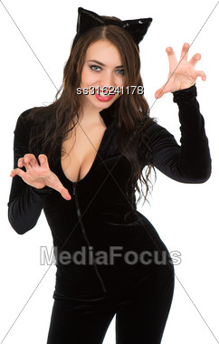 Playful Woman Dressed In Catsuit And Showing Her Teeth. Isolated On White Stock Photo
