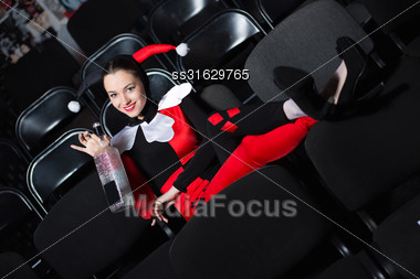 Playful Woman Wearing Jester Costume Posing With Bottle Stock Photo