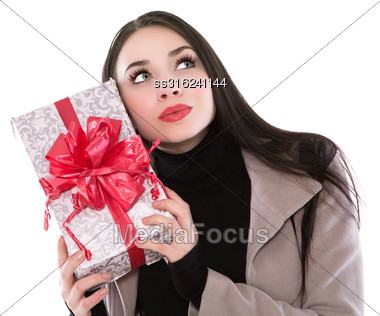 Playful Young Brunette Posing With A Fancy Box. Isolated On White Stock Photo