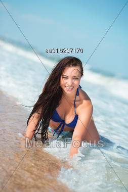 Playful Young Brunette Posing On The Beach Stock Photo