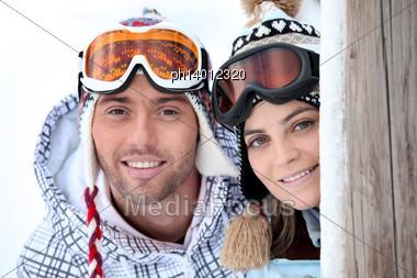 Playful Young Couple Enjoying Their Skiing Holiday Stock Photo