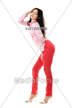 Playful Young Woman In Red Jeans. Stock Photo