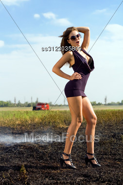 Playful Young Woman In The Smoky Field Stock Photo