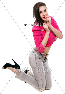 Playful Young Woman In Short Pink Jacket Standing On Her Knees. Isolated On White Stock Photo
