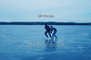 Playing Hockey Together Stock Photo